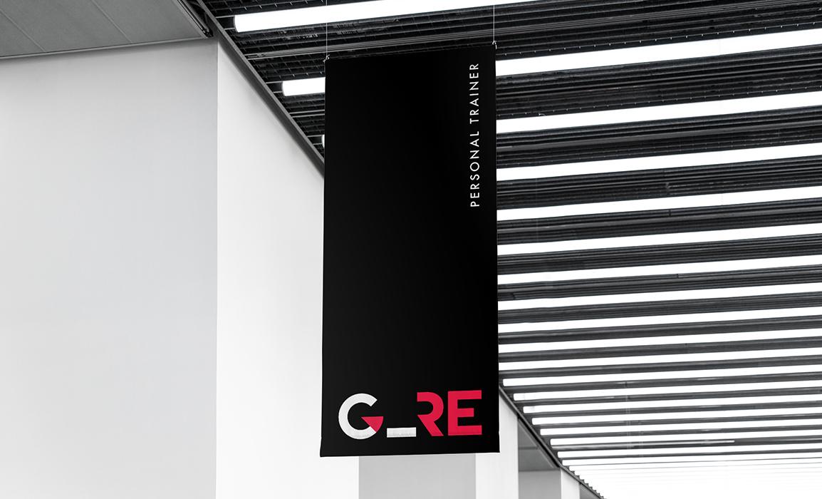 Progettazione grafica di un'espositore per interni con marchio in negativo.