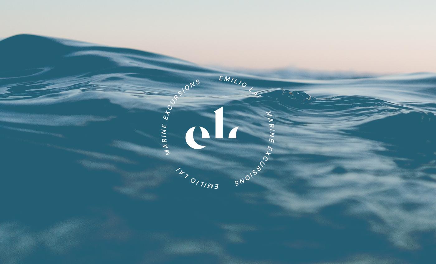 Il marchio Emilio Lai è un monogramma stilizzato delle iniziali del nome. Lo stile è elegante ma allo stesso evoca in maniera ponderante l'ambiente marinaresco.